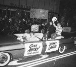 Gene Autry, the singing cowboy, and radio personality Johnny Grant in the parade in 1961. Hollywood Photograph Collection.
