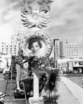 Film actress Claudette Colbert by her Christmas wreath in Hollywood, 1932. Hollywood Photograph Collection.