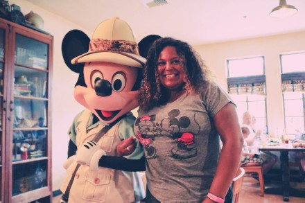 I am not embarrassed to admit that I love posing with Disney characters. (Image by Girl Gone Travel)
