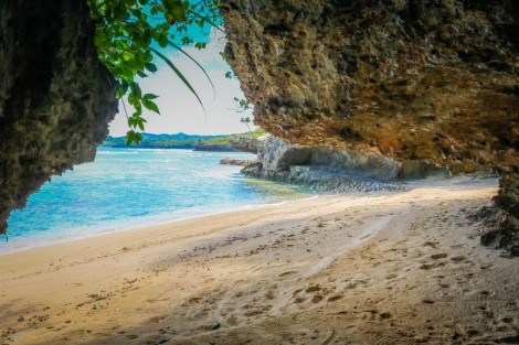 One of the hidden beaches of Savasi Island. Photo by Girl Gone Travel.